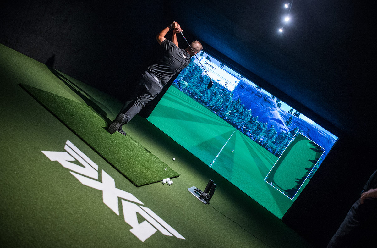 PXG Headquarters interior - golf simulator being played